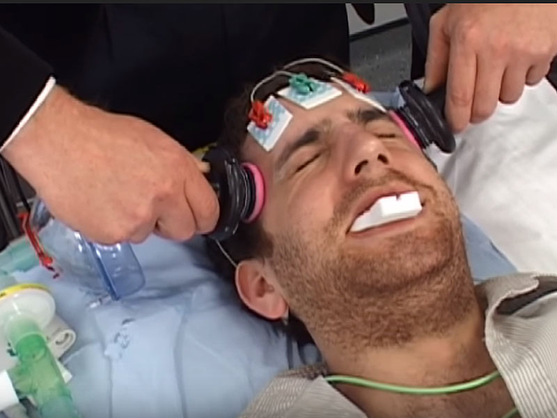 A patient undergoing ECT. Screenshot from ECT in Modern Psychiatry on YouTube.